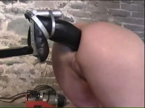 Fuckmachine with colossal size strapon anal amateur