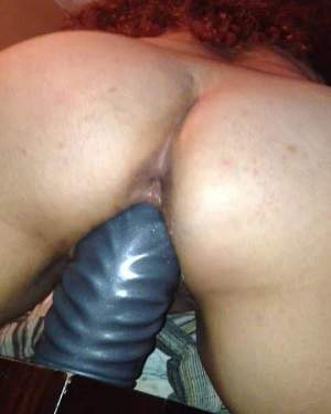 Curly milf fantastic rides on a huge dildo