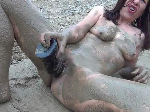 Dirty mature outdoor dildo fuck in the mud