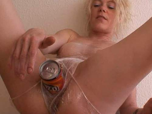 Roll up in plastic wrap girl puts a can in pussy