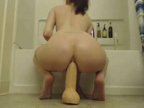 Booty girl rides on a huge toy in the bathroom