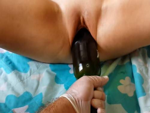 Deeply wine bottle insertion in wifes smooth pussy