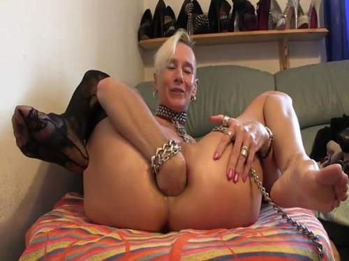 Crazy skinny mature stretching solo her anal hole