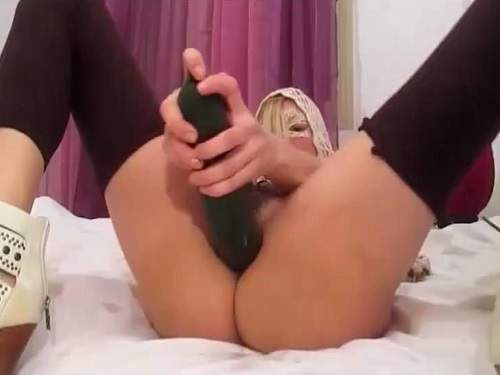 Booty masked blonde riding on a huge vegetable