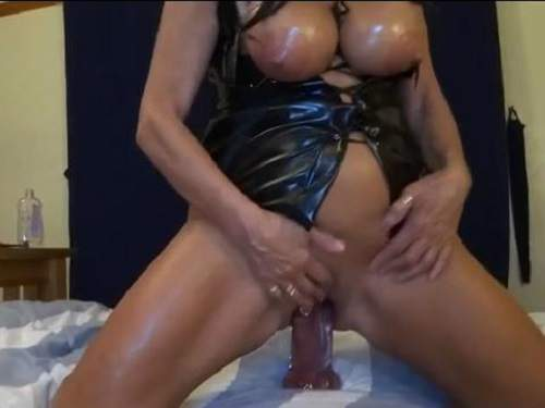 Mature with huge silicone tits riding on a big toy