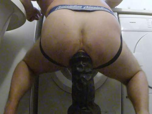Hairy husband solo riding on a shocking black dildo