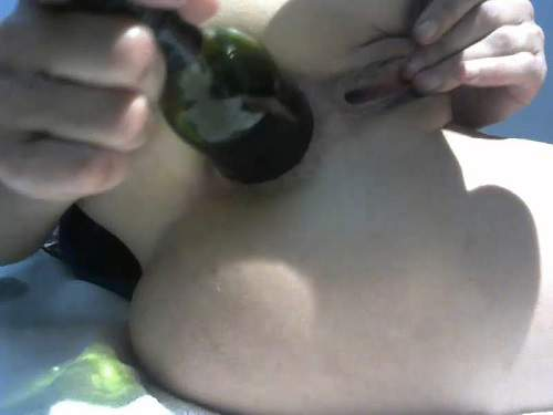 Big beer bottle and huge dildo deep in ruined anus rosebutt