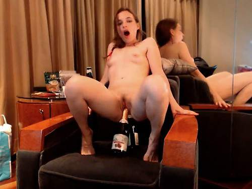 Wonderful girl Little Miss rides on a two big champagne bottles