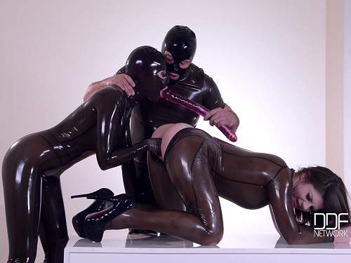 Rubber girls domination and closeup fisting