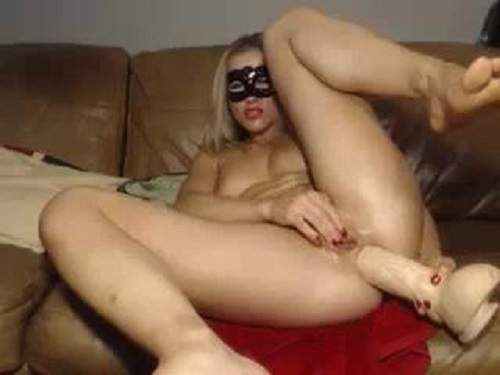Exciting masked girl herself huge dildo anal penetrated