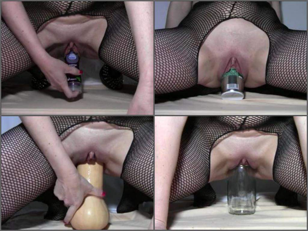 Woman with wine bottle in pussy