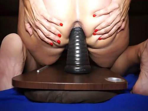 Pyramid dildo deeply penetrated into wife pussy