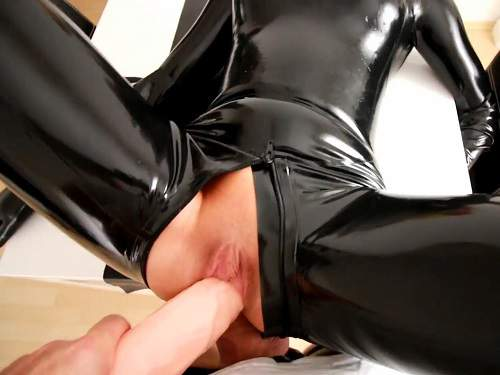 Sexy rubber blonde gets double penetration with big dildo