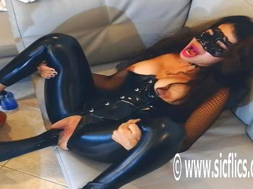 Masked latex brunette monster dildo rides and gets fisted