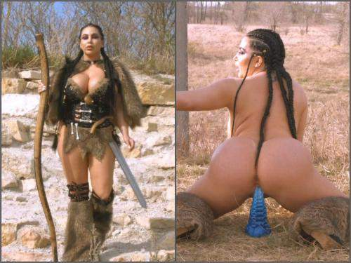 Warrior amazon girl rides on a huge tentacle dildo outdoor