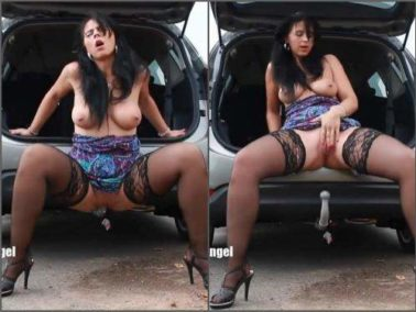 Dildo riding - Big tits MILF with piercing labia outdoor rides on a hitch