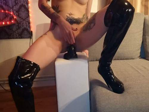 Boots fetish – Tattooed Slut_lucy wear long black boots and rides on a dildo