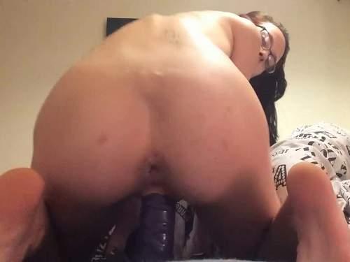Pussy insertion – Webcam skinny brunette rides on a long black dildo
